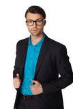 Young businessman black suit casual poses. Young businessman black suit in glasses casual poses at studio Royalty Free Stock Photography