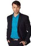 Young businessman black suit casual poses. At studio Royalty Free Stock Image