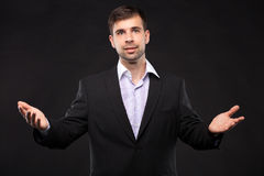 Young businessman in a black suit Stock Photography