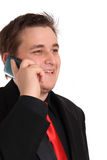 Young businessman in black talking on cellphone Royalty Free Stock Photo