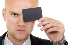 Young businessman with blank card in his hand Stock Photos