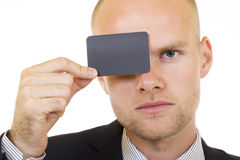 Young businessman with blank card in his hand Stock Image