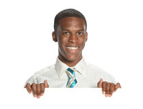 Young Businessman with blank sign Royalty Free Stock Image