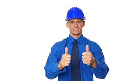 Young businessman in a  blue helmet. Royalty Free Stock Images