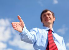 Young businessman in a blue shirt and red tie Royalty Free Stock Photo