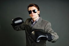 Young businessman boxing Stock Photos