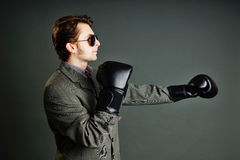 Young businessman boxing Stock Images