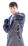 The young businessman in boxing gloves. Stock Image