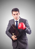 Young businessman with boxing gloves Royalty Free Stock Images