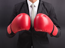 Young businessman with boxing gloves Royalty Free Stock Photo