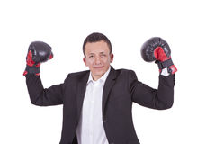 Young businessman with boxing gloves flexing biceps Royalty Free Stock Photos