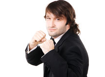 Young businessman in boxing pose Stock Images