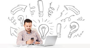 Young businessman brainstorming with drawn arrows and symbols Stock Image