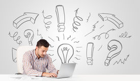 Young businessman brainstorming with drawn arrows and symbols Stock Photo