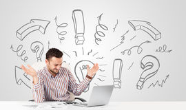 Young businessman brainstorming with drawn arrows and symbols Royalty Free Stock Images