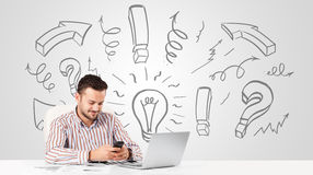 Young businessman brainstorming with drawn arrows and symbols Stock Photography