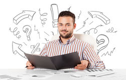 Young businessman brainstorming with drawn arrows and symbols Stock Photos