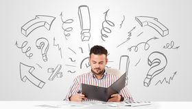 Young businessman brainstorming with drawn arrows and symbols Royalty Free Stock Photos
