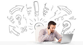 Young businessman brainstorming with drawn arrows and symbols Stock Images