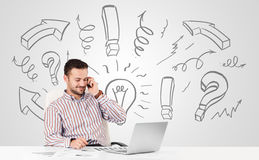 Young businessman brainstorming with drawn arrows and symbols Royalty Free Stock Photography