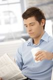 Young businessman on break reading papers Royalty Free Stock Photos