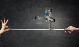 Young businessman breakdancer . Mixed media Royalty Free Stock Photo