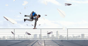 Young businessman breakdancer . Mixed media Stock Images