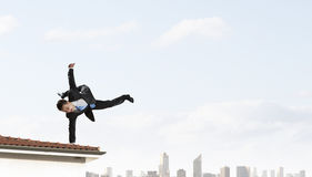 Young businessman breakdancer. Mixed media Royalty Free Stock Photo