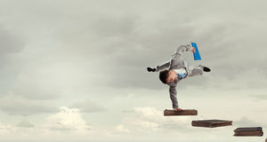 Young businessman breakdancer. Mixed media Stock Photos