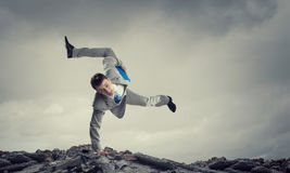 Young businessman breakdancer. Mixed media . Mixed media Royalty Free Stock Photos