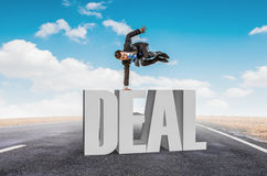 Young businessman breakdancer. Mixed media . Mixed media Royalty Free Stock Image