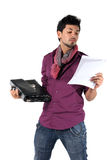 Young businessman with a briefcase. On the white background. A man reads a document stock photography