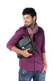 Young businessman with a briefcase. On the white background royalty free stock photography