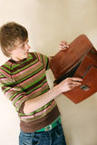 Young businessman with briefcase. Young IT businessman in casual clothes with briefcase stock photo