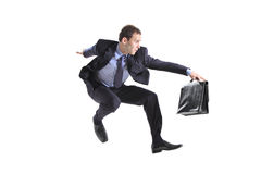 Young businessman with a briefcase jumping Royalty Free Stock Images
