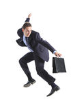 Young businessman with a briefcase jumping Stock Photos