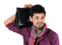 Young businessman with a briefcase on the white. Background Stock Images