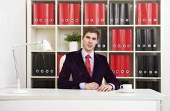 Young businessman in bright office Royalty Free Stock Images