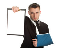 Young businessman with broken hand with blank card Royalty Free Stock Images