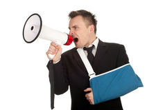 Young businessman with broken hand and megaphone Stock Photo