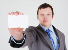 Young businessman with a business card Stock Photography