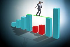 The young businessman in business concept with bar charts. Young businessman in business concept with bar charts Stock Photo