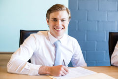 Young businessman in business meeting Royalty Free Stock Images