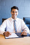 Young businessman in business meeting Royalty Free Stock Photography