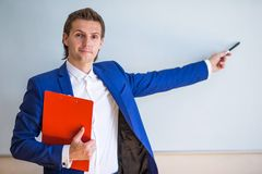 Young businessman with business plan and financial Royalty Free Stock Photo