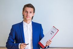 Young businessman with business plan and financial Royalty Free Stock Photography
