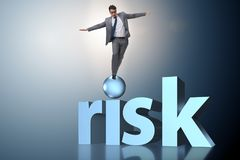 The young businessman in business risk and uncertainty concept Stock Photography