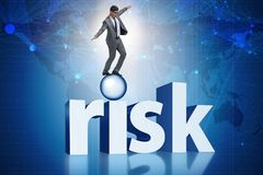 The young businessman in business risk and uncertainty concept Royalty Free Stock Photos