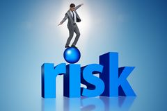 The young businessman in business risk and uncertainty concept Stock Photo
