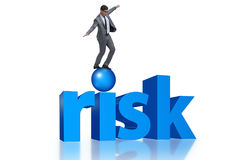 The young businessman in business risk and uncertainty concept Stock Image